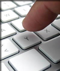 Person typing email on keyboard