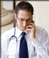 Doctor dictating over a phone and using Transcription Connection's toll                                        free phone system.